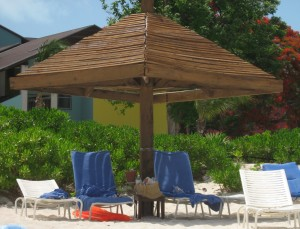 Beach chairs under umbrella in the Caribbean
